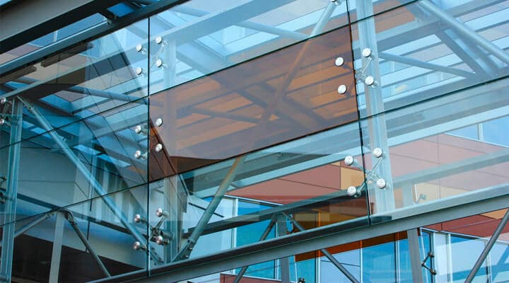 SADEV - World Leader In Architectural Glass Systems for applications including facades, canopies, interior partitions, and balustrades. - Discover more at SOLUZIOIN Singapore